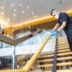 Hilton hotel being cleaned by man in mask